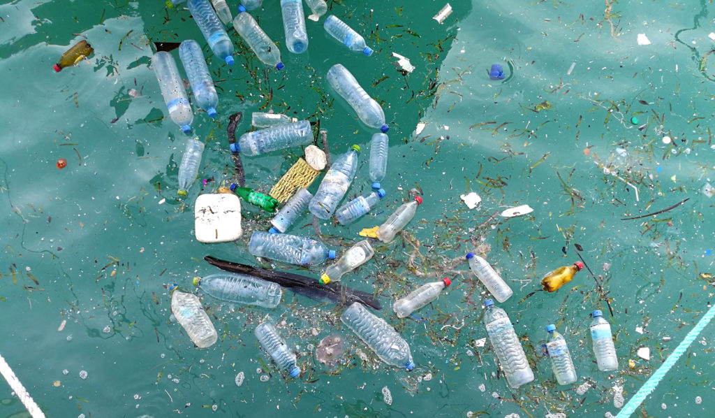 Plastic waste floating in water